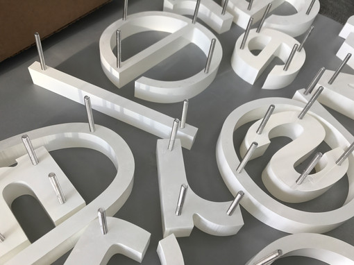 Pin mounted lettering
