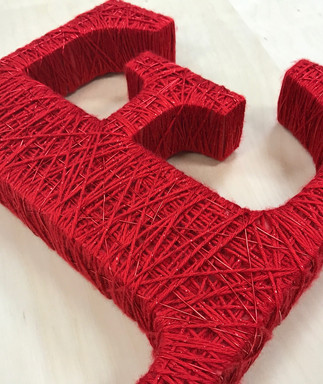 Yarn wrapped dimensional lettering