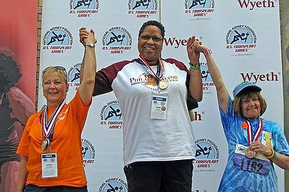 Janet Dennis celebrating medal discus Ga