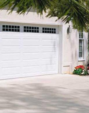 white lincoln residential steel garage doors