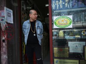 À Pékin, des codes couleur pour les commerces indiquent le pourcentage de vaccinés