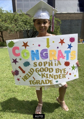 Student with congratulations poster