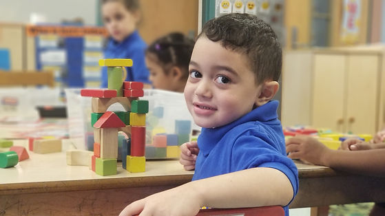 Student playing with blocks