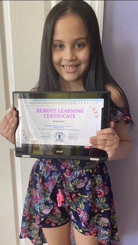 Student smiling while holding certificate