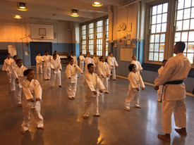 Students taking a martial arts class