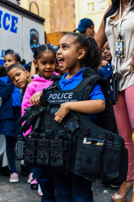 Student with police vest smiling