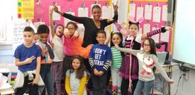 Teacher posing with her class