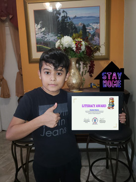 Student posing with certificate
