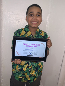 Student Smiling and holding certificate