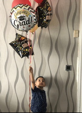 Student holding balloons