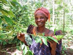 Beneficiary woman farmer with a shade gi