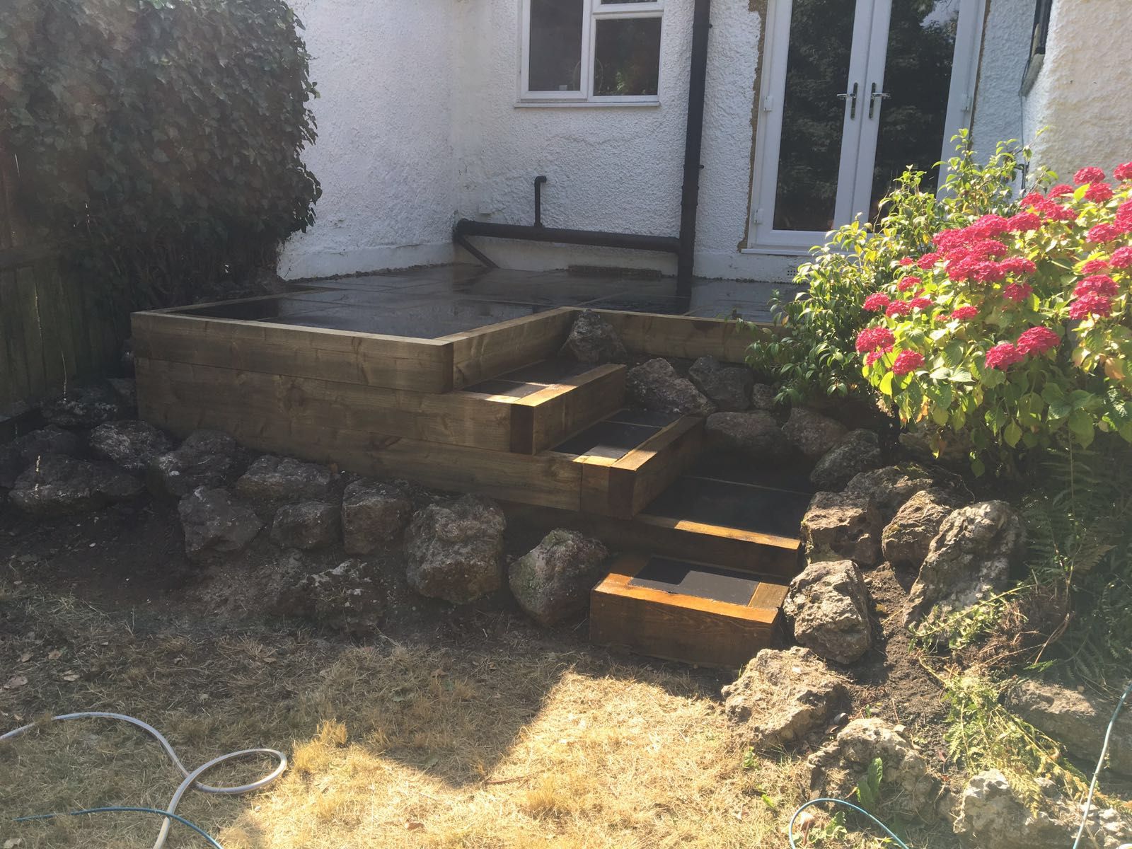 Limestone patio and steps in Bushey