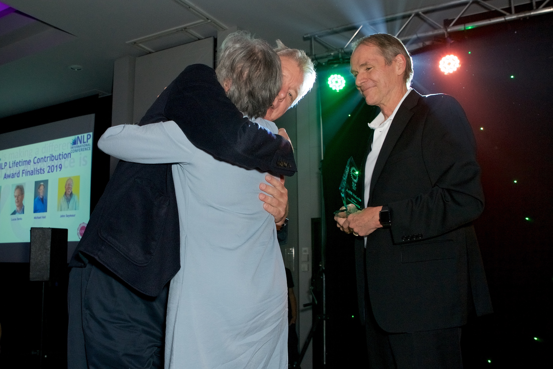 Judith DeLozier winning NLP Award