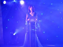 Karen Moxom announcing winners