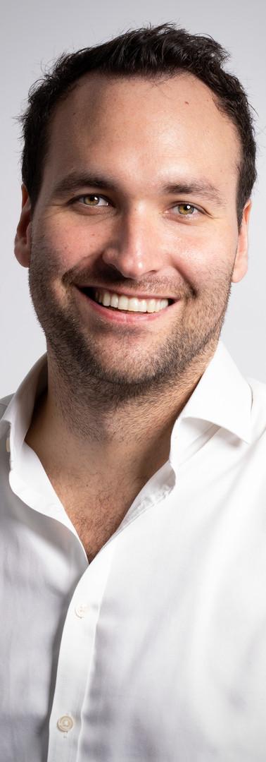 01 -Headshot corporate man white backgro