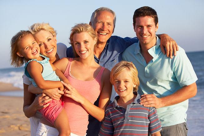 Portrait Of Three Generation Family On B