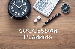 Succession planning written on wooden ta
