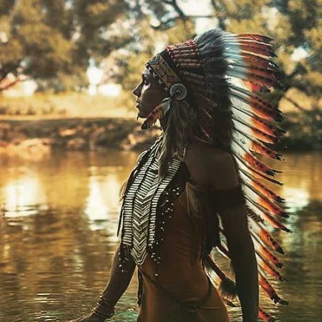 A girl in an a native America war bonnet