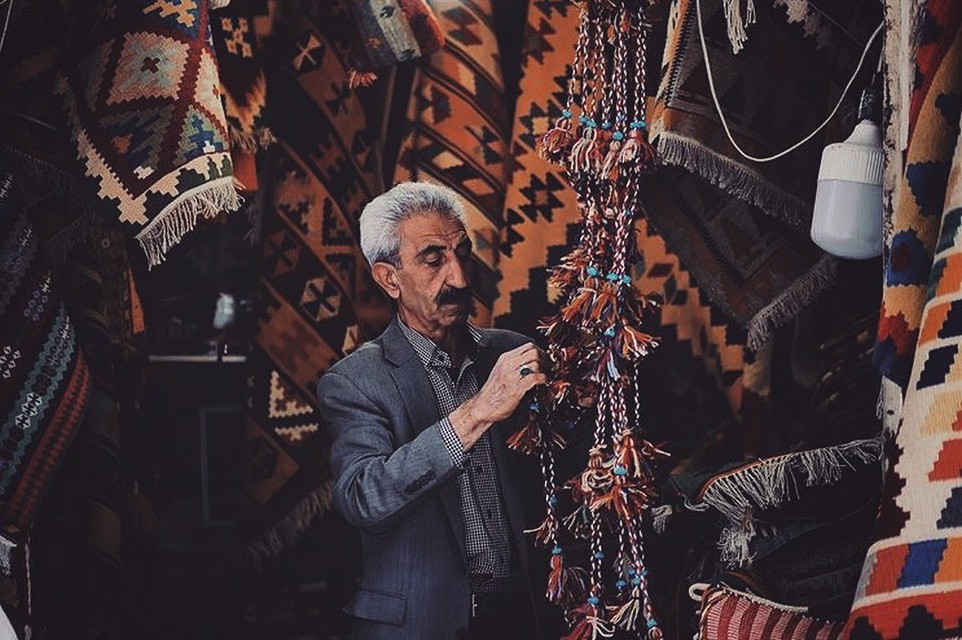 a man working in his rug shop