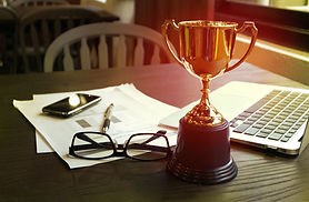Trophy on work table, win concept.jpg