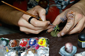 Hands painting toy soldier