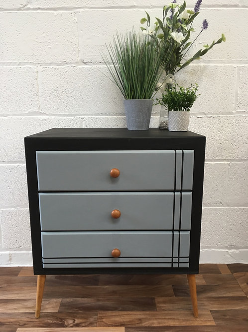 Retro black and grey painted chest of drawers.