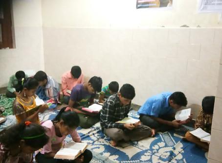 Rohingya Christian reading Bible as daily manna