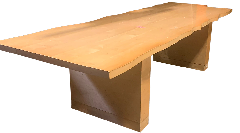 light wood decorative dining table with wavy edges on part of the side, diagonal side view