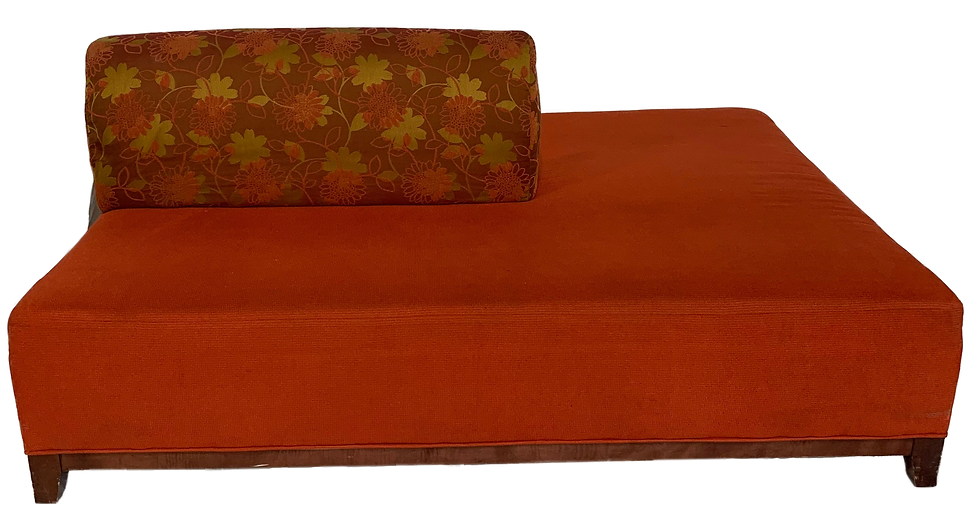 flat red couch with flower print pillow on the left
