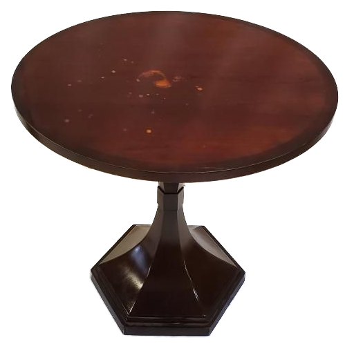 round wood pedestal table with some markings on top and hexagonal base top view