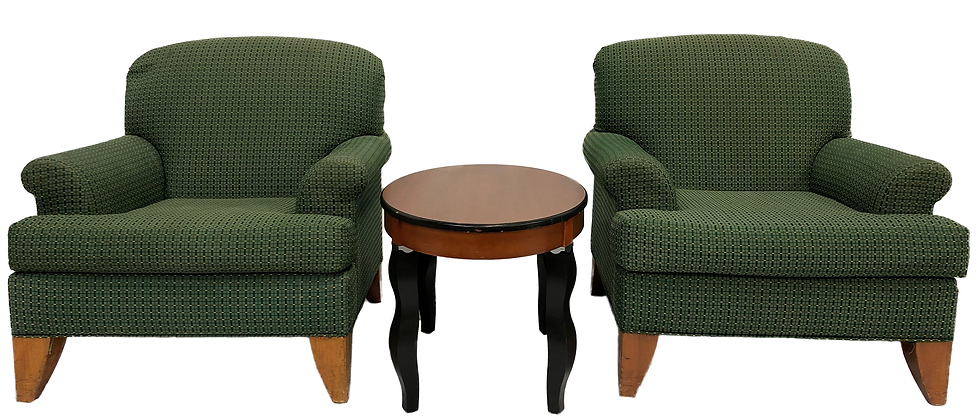 2 green armchairs with circular coffee table in the middle