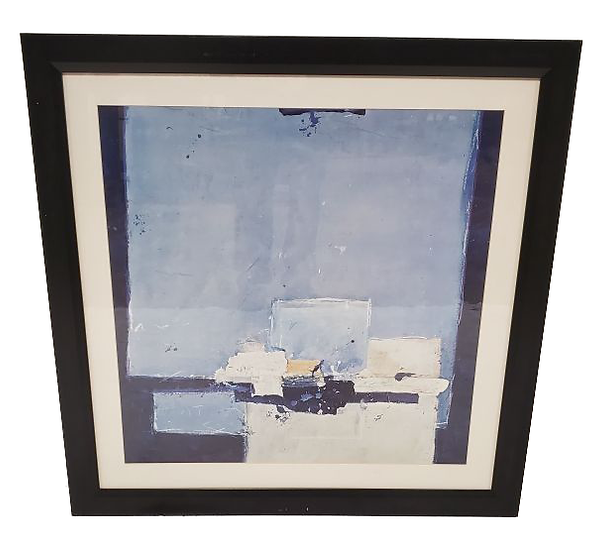 abstract print of blue squares in dark frame front view