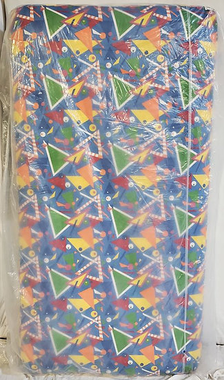 new twin mattress with multi colored geometrical pattern wrapped in plastic standing up on end