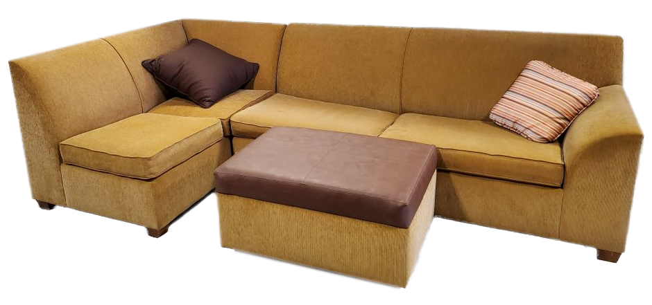 large yellow sectional with two throw pillows and rectangular yellow ottoman with brown top. chaise on left side