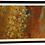 brown framed abstract painting in red, orange, yellow, gold, fall colors