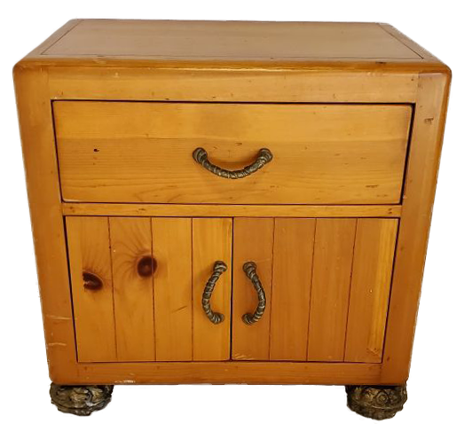 light wood nightstand with carved feet and handles, one drawer and two doors front view