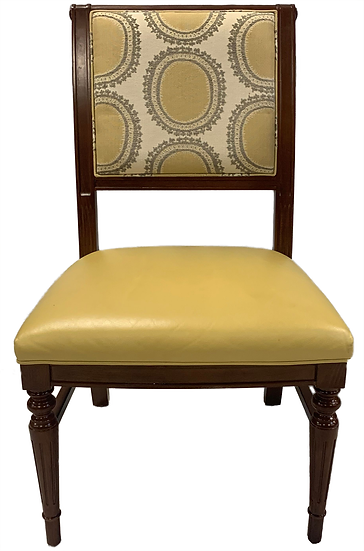 wood dining chair with yellow vinyl seat and yellow and white circular pattern on back front view