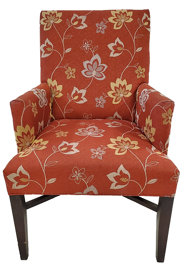 red armchair with tan flower pattern