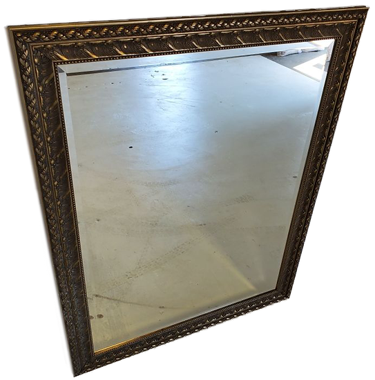vanity mirror with gold frame with engraved details front view from top