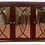 wood buffet table with three doors with glass panels front view