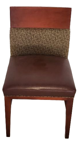 wood chair with brown vinyl seat and tan and line patterned back front view