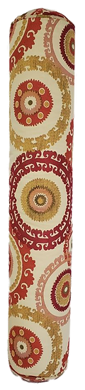 long bolster pillow with red, gold and cream circular pattern, standing on end side view