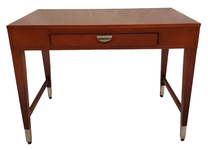 wooden desk with metal on the bottom of legs and one drawer with metal pull