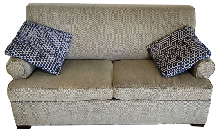 gray blue sofa bed with 2 white pillows with navy blue polka dots on each side front view