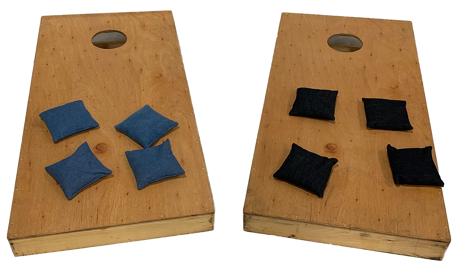 two cornhole boards with 4 blue beanbags on left and 4 black bean bags on right