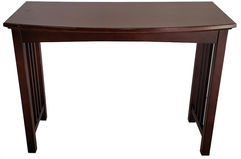 Dark wood sofa table. one side is straight and the other side is curved. side view