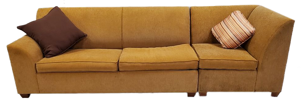 gold sofa bed with high right side and two throw pillows one brown and one striped