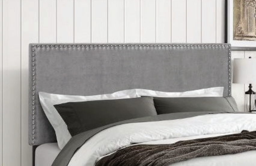 gray headboard with pillows and sheets on bed