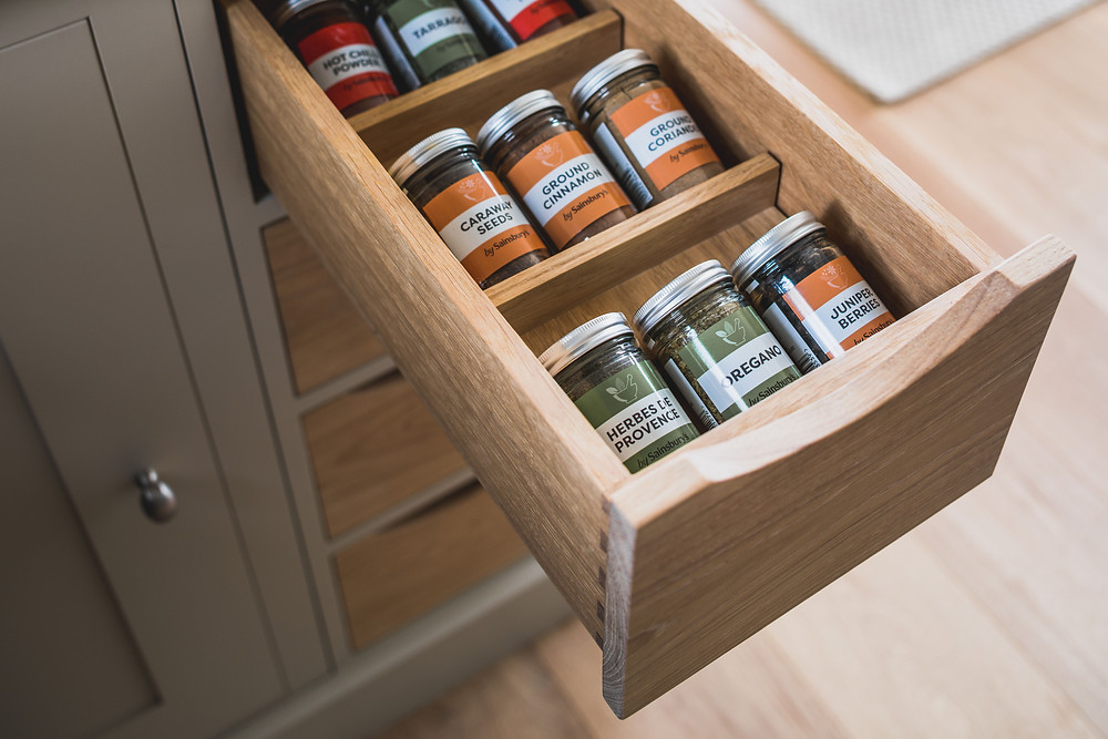 Small oak drawer cabinet with wooden wedges to make it easier and quicker to access herbs and spices whilst cooking
