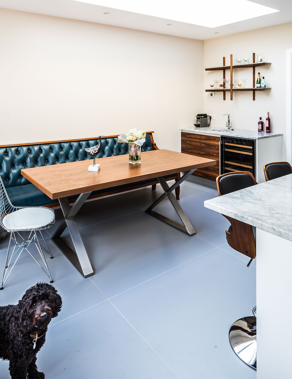 Pickles the dog sitting in a spacious kitchen diner space designed and built by Steven Andrews Bespoke